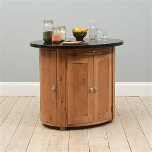 28 oak granite top oval kitchen oval kitchen island with oak top roll out leg granite top kitchen islands from the cotswold company