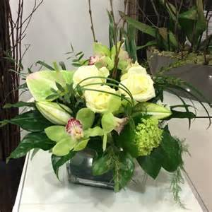 classic creams greens and white flower arrangement in a