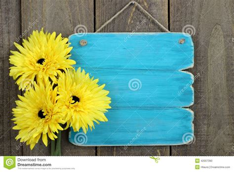 yellow and white with teal blank antique blue sign with large yellow sunflowers