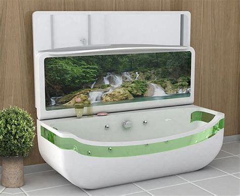 bathtub with tv whirlpool bath tub with oled tv folds into basin gizmodo australia