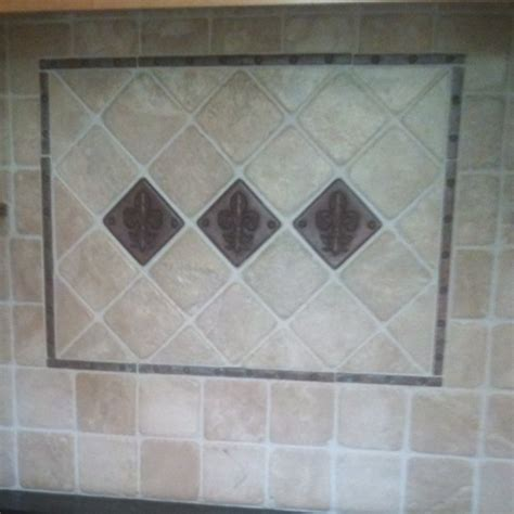 fleur de lis copper accents and tumbled marble tiles
