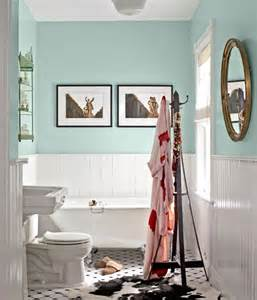 Cottage style bathroom with mint green walls clawfoot tub and white