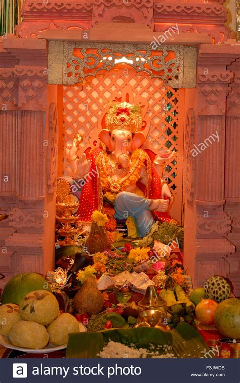 Shree Ganesh Decoration by Idol Lord Ganesh Decoration Fruits Flowers Worship
