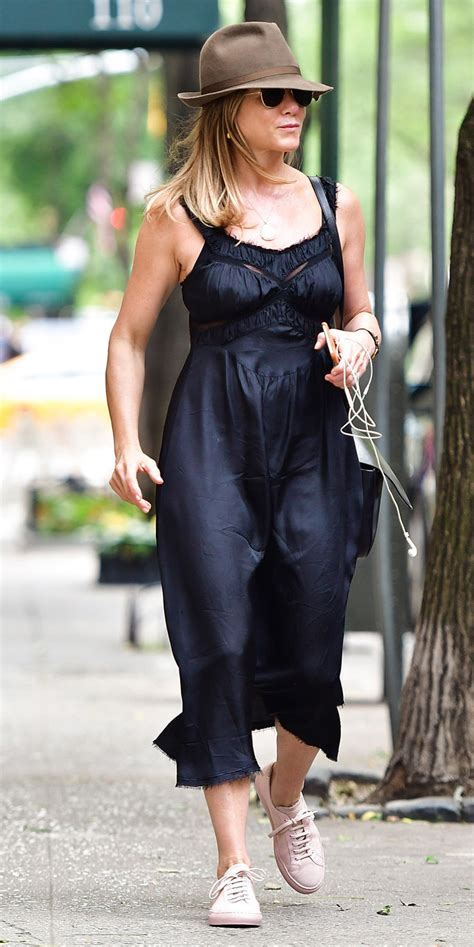 jennifer aniston casual jennifer aniston wears a curve flattering black dress in n
