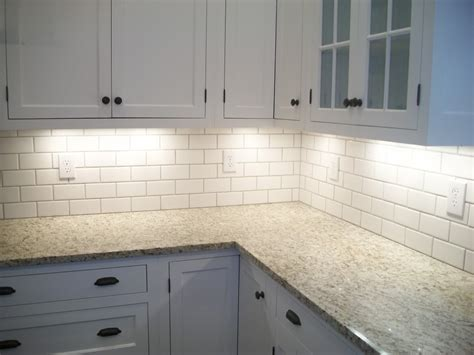 white kitchen cabinets with white backsplash granite countertop subway tile backsplash white