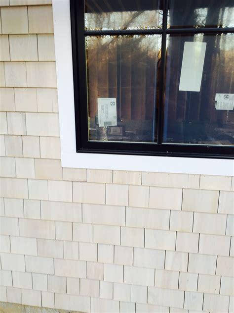 pella black casement windows maibec white cedar shingle with bleaching next to