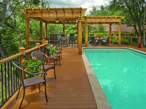 swimming pool decks above ground pool with deck and slide landscaping gardening ideas