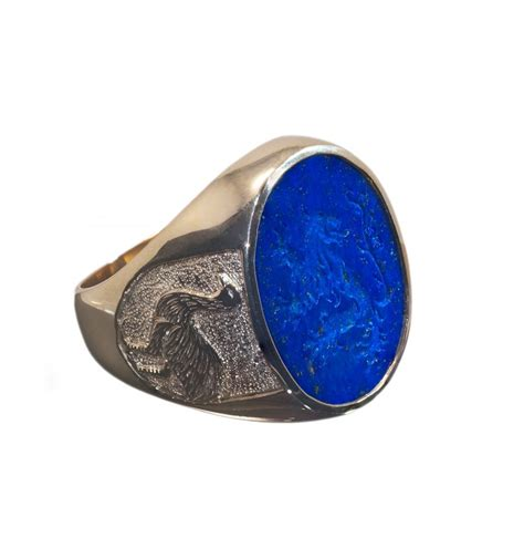 a lapis seal ring with a heraldic and