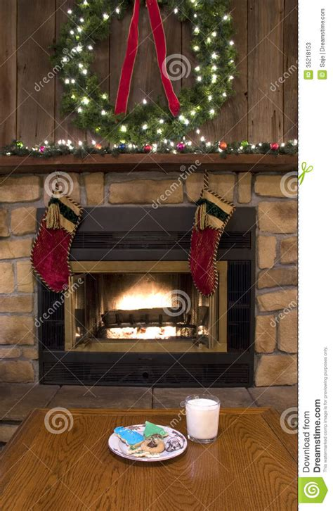 fireplace hearth with cookies and milk for santa
