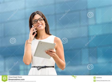 uzbek women stock photos uzbek women stock images alamy business executive with tablet and phone royalty free