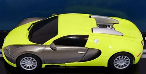 yellow and silver bugatti bugatti veyron scalextric