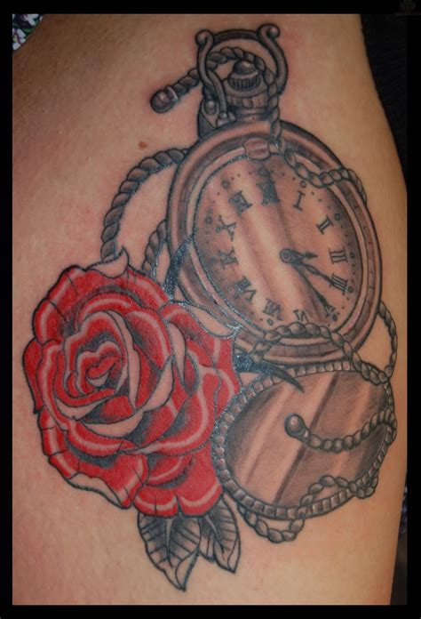 pocket watch and roses tattoo and pocket