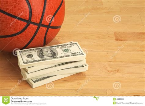 100 Dollar Bill On The Floor - basketball and one hundred dollar bills on wooden court
