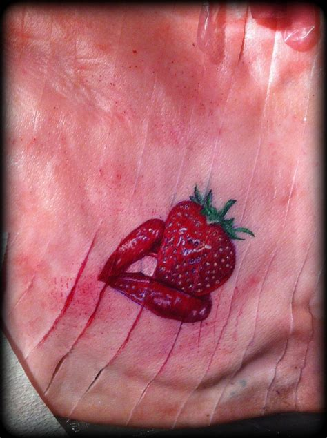 strawberry and red lipstick tattoo pig skin by