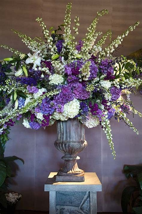 big wedding flower arrangements pair hydrangeas with delphinium for a variety of heights