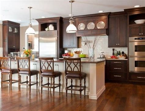 dark cabinets white island white backsplash   floor   lighter   cabinets