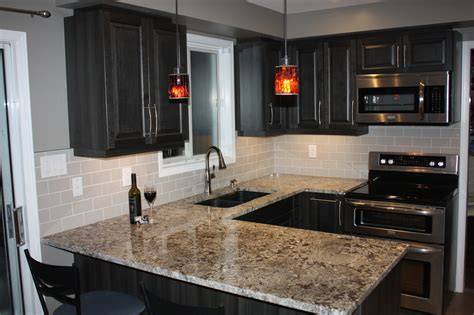 dark cabinets with black granite