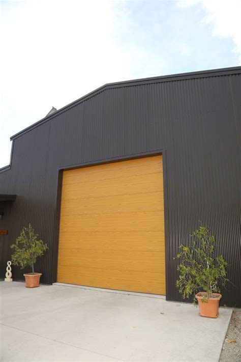 Slimline Shed With Roller Door by Construction Company Sheds Nz Shed Builders New Zealand
