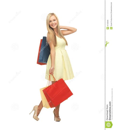 high heels shopping with shopping bags in dress and high heels stock
