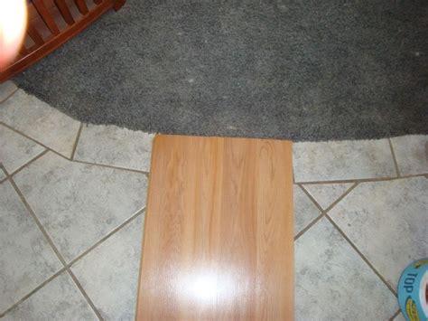 can laminate flooring be laid ceramic tiles