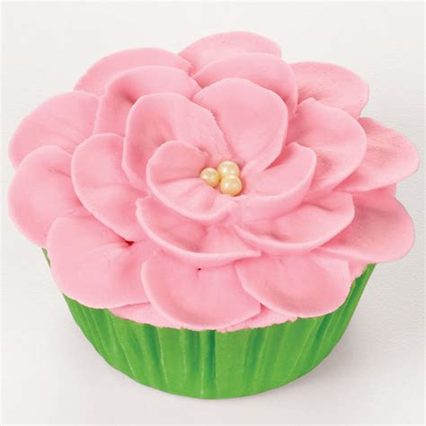 flower decorating tips piping a flower on a cupcake wilton