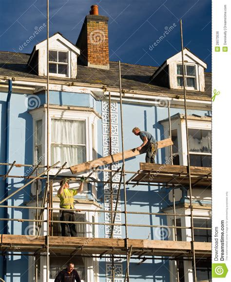 Construction Building Workers Repairing House Editorial