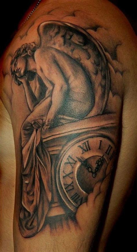 sad angel and watches tattoo on shoulder tattooimages biz