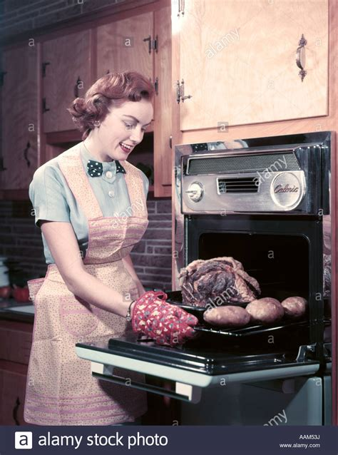 What Do You Wear While Cooking by 1950s Smiling Wearing Apron And Oven Mitts