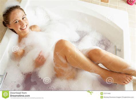 bathing in bathtub woman relaxing in bubble filled bath royalty free stock