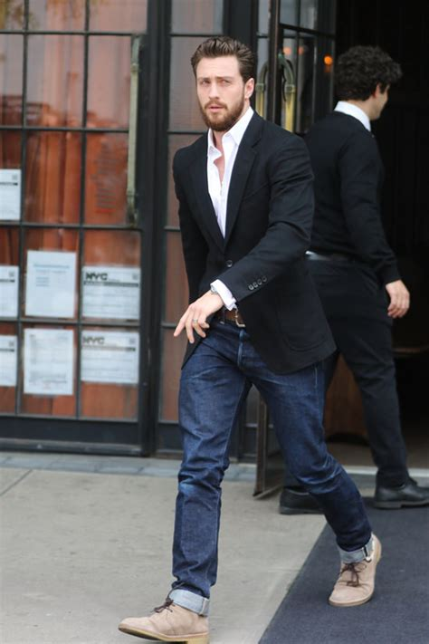 aaron taylor johnson looks like aaron taylor johnson struts as he heads to his quot build