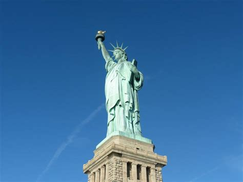 statue of liberty reopens the mystery behind the lady statue of liberty reopens despite government shutdown