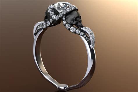 vapor skull ring with half carat center 14k gold