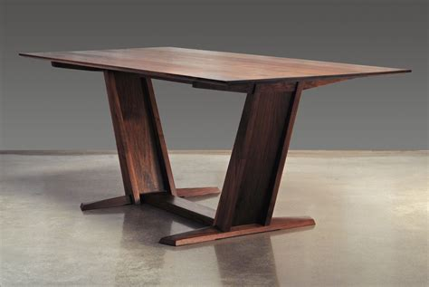 custom leaning trestle dining table by eben blaney