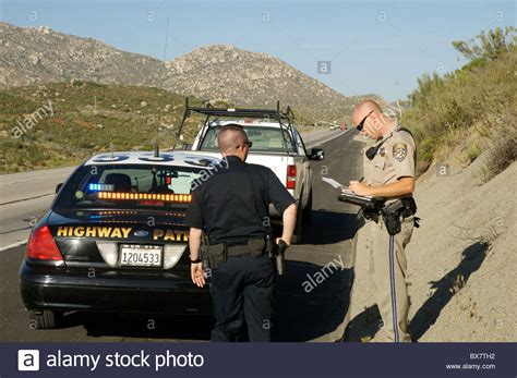 Officer In California by A Local Officer Assists A California Highway Patrol