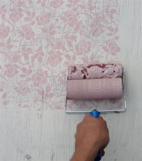 wallpaper paint roller paint grey or gold flowers over blue in bedroom