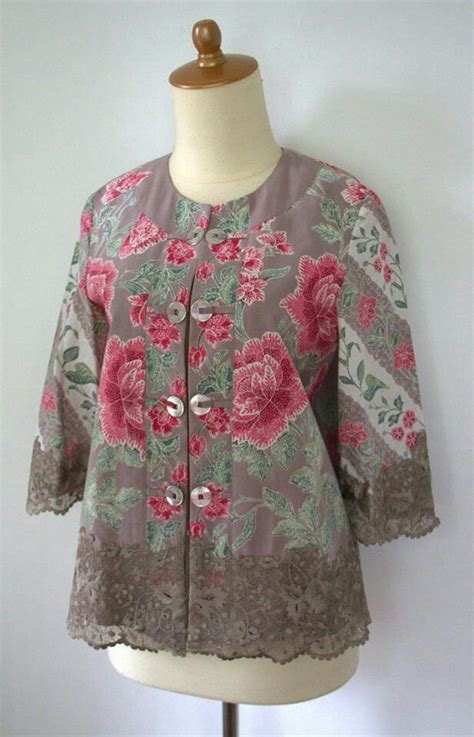 Blouse Batik Serasi Verina Kuning the peranakan straits kebaya worn with a sarong a set of krosang broches the