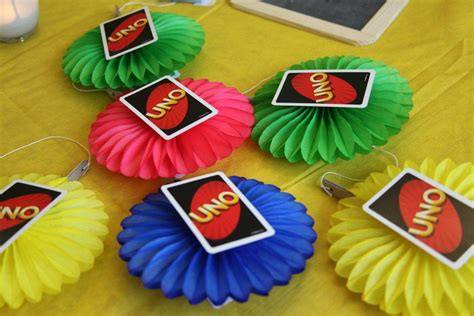 paper fans party city uno themed birthday for baby turning one the paper fans