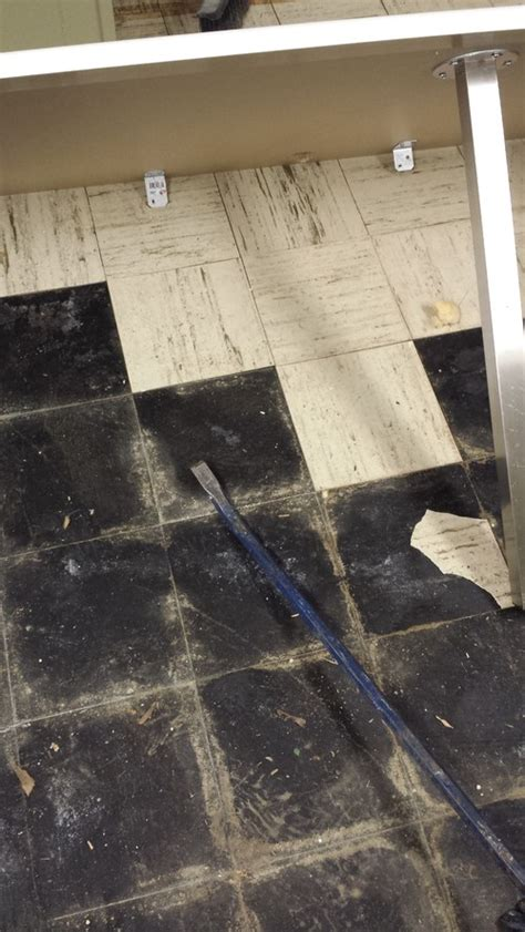 Black Adhesive Floor Tiles by What To Do With Asbestos Floor Tile And Black Adhesive
