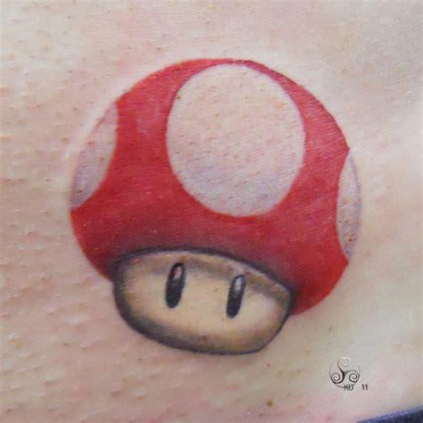 mario mushroom tattoo a of a recent design of the mario magic
