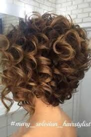 stacked permed hairstyle spiral perm with a stacked bob cut pinteres