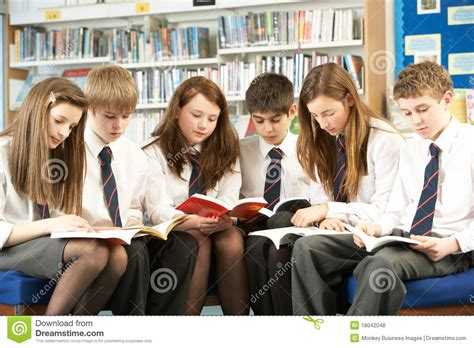 pictures of students reading books students in library reading books stock photo