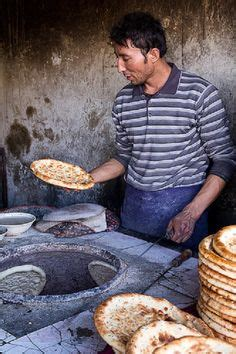 Oven Ichibo baking bread on the wall of a conical oven iran bread baking breads