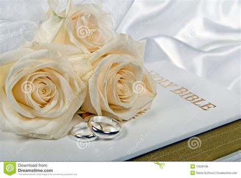 Wedding Bible Pictures by Wedding Rings And Roses On Bible Stock Photo Image 13528198