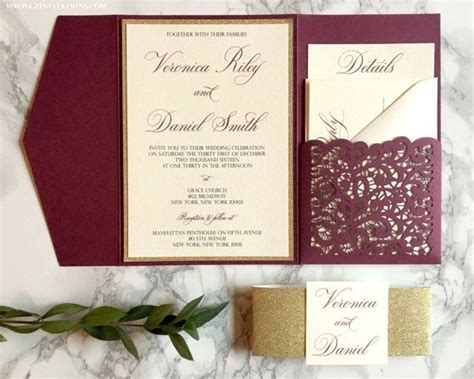 wedding invitations burgundy and gold lace laser cut pocket wedding invitation in burgundy and gold glitter by cz invitations