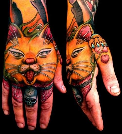 cat tattoo in hand awesome portrait of a japanese cat tattoo on hand