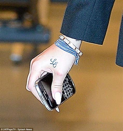 tattoo on khloe kardashian wrist kendall jenner says she s sticking with sister kim s no