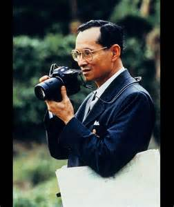 king bhumibol adulyadej takes a picture dated 1995 king