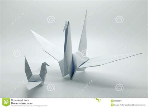 White Origami - white origami crane bird paper stock photo image 55588377