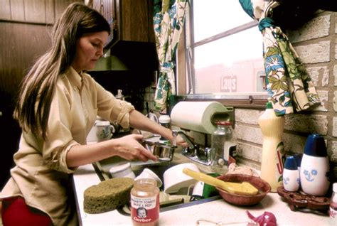 house wife file housewife in the kitchen of her mobile home in one of