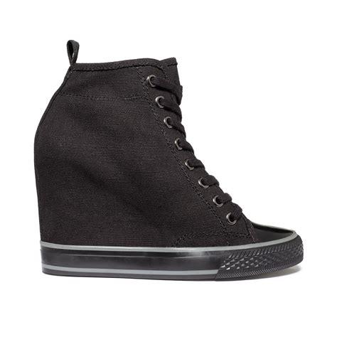 dkny grommet wedge sneakers in black black canvas lyst
